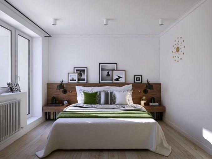 Интерьер спальной комнаты в скандинавском стиле с картиной