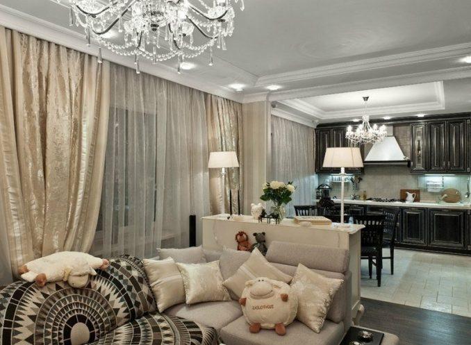 Светлая гостиная, совмещённая с темной кухней в классическом стиле